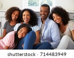 portrait of smiling family... | Shutterstock . vector #714483949