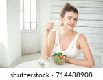 girl is sitting at the table...   Shutterstock . vector #714488908