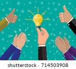 businessman hand holding idea... | Shutterstock .eps vector #714503908