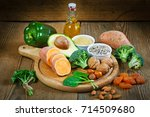foods rich in vitamin e such as ... | Shutterstock . vector #714509680