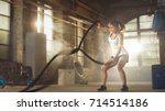 athletic female in a gym... | Shutterstock . vector #714514186