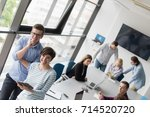 two business people using... | Shutterstock . vector #714520720