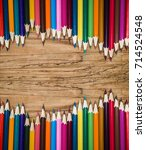 Small photo of Color pencils on wooden table background. Close up. new wave. high level