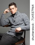 sexy young man in warm knit... | Shutterstock . vector #714537964