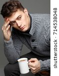 sexy young man in warm knit... | Shutterstock . vector #714538048