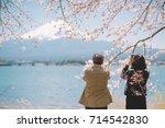 mt.fuji in kawaguchiko lake... | Shutterstock . vector #714542830