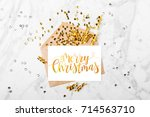 merry christmas card and gold... | Shutterstock . vector #714563710