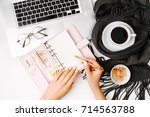 woman writes in the planner.... | Shutterstock . vector #714563788