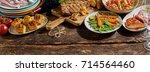 gourmet grilled meats ... | Shutterstock . vector #714564460
