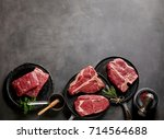 raw steaks and frying pans with ... | Shutterstock . vector #714564688