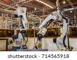 industrial robot is test run... | Shutterstock . vector #714565918