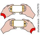 hand grab phone | Shutterstock .eps vector #714567970