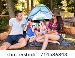beautiful young family with... | Shutterstock . vector #714586843