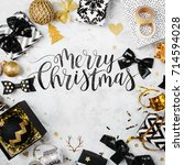 merry christmas card with black ...   Shutterstock . vector #714594028