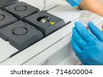 Small photo of The scientist woman hands in gloves, during test on mass spectrometer in chemistry lab