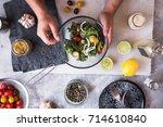 eating detox salad avocado kale ... | Shutterstock . vector #714610840