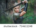 a beautiful warrior girl with a ... | Shutterstock . vector #714611248