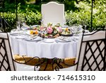 round banquet table served with ... | Shutterstock . vector #714615310