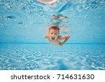 happy small cute boy swim and...   Shutterstock . vector #714631630