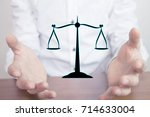 man holding scales. law concept.