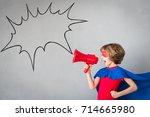 child pretend to be superhero.... | Shutterstock . vector #714665980