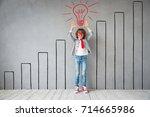 child pretend to be businessman.... | Shutterstock . vector #714665986