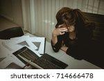 asian businesswoman stress from ... | Shutterstock . vector #714666478