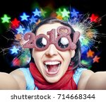 young woman in glasses in the... | Shutterstock . vector #714668344