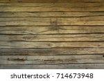 old wooden wall of oak planks  ... | Shutterstock . vector #714673948