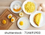 Small photo of Various ways of cooking chicken eggs. Omelette, poached, soft-boiled, hard-boiled, fried, scrambled eggs. Top view. Close-up.
