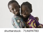 african couple of brother and... | Shutterstock . vector #714694783