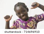 little african child showing... | Shutterstock . vector #714696910