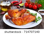 roasted chicken leg quarters... | Shutterstock . vector #714707140
