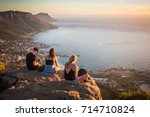 young man and women sitting on... | Shutterstock . vector #714710824