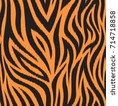 seamless pattern with tiger... | Shutterstock .eps vector #714718858