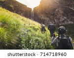 group of tourists walking... | Shutterstock . vector #714718960