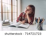 little cute girl is bored and... | Shutterstock . vector #714721723