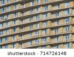 a lot of windows and balconies... | Shutterstock . vector #714726148