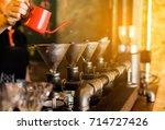 drip brewing  filtered coffee ...   Shutterstock . vector #714727426