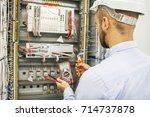 electrical engineer adjusts...   Shutterstock . vector #714737878
