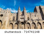 papal palace in avignon in a... | Shutterstock . vector #714741148