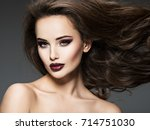 beautiful young woman with long ... | Shutterstock . vector #714751030