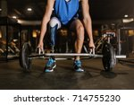 disabled young man training in... | Shutterstock . vector #714755230