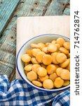 tasty lupins in metal mug on... | Shutterstock . vector #714762874