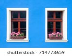 two windows with boxes full of... | Shutterstock . vector #714773659