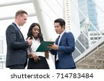 multicultural colleagues... | Shutterstock . vector #714783484
