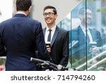 two businessmen talking outdoors | Shutterstock . vector #714794260