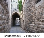 narrow alley in the historical... | Shutterstock . vector #714804370