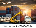 forklift handling container box ... | Shutterstock . vector #714840334
