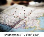 closeup of pins on the map... | Shutterstock . vector #714841534